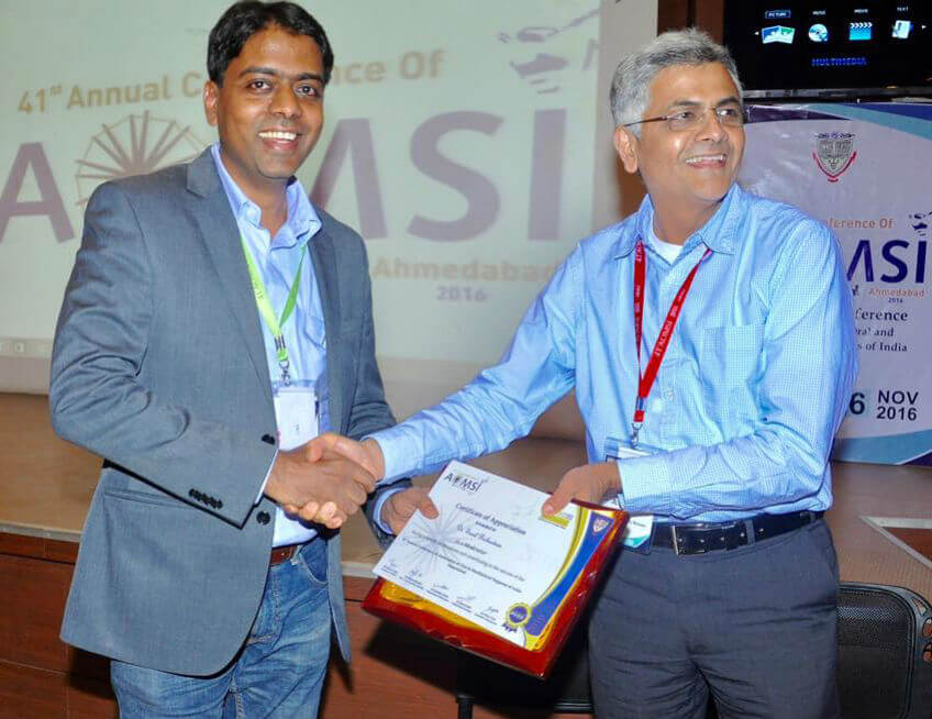 Receiving the certificate and plaque from Dr Krishnamoorthy Editor of Indian maxillofacial journal after moderating the session on cleft maxillary hypoplasia at the national conference in Ahmedabad